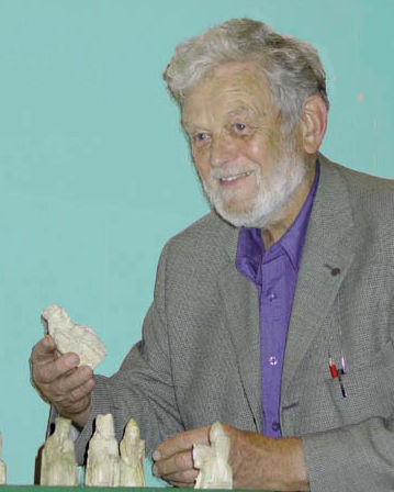 Peter Firmin with the Lewis Chessmen, the inspiration for Noggin the Nog.